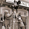 Mickey Mouse, Pluto, Goofy hang the 100 millionth guest sign at Disneyland